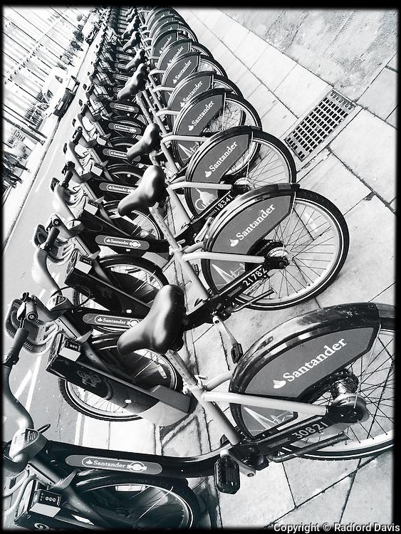 Rental bikes, London, England. Black and white.