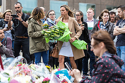 © Licensed to London News Pictures. 05/06/2017. London, UK. A woman lays flowers at London Bridge for those that lost their lives in the terrorist attack that took place on Saturday 3 June 2017. Three attackers drove a van at pedestrians before stabbing a number of people in nearby bars. Photo credit: Rob Pinney/LNP