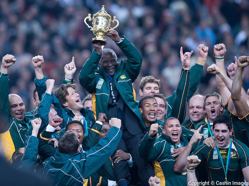 The South African rugby team hoist up President Thabo Mbeki with the Webb Ellis Cup  after the 2007 Rugby World Cup Final at Stade de France in Paris, France