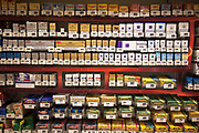 Cigarettes for sale at a supermarket. Currently laws allow for cigarette packets to be put on display in shops. This will change in the coming years to ban these displays first from supermarkets, and then from smaller shops in an attempt to stop the temptation especially to younger smokers.