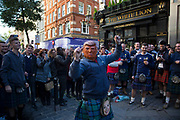 Scotland fans including one with a Donald Trump mask in joyous mood drinking and singing together  in Covent Garden ahead of their football match, England vs Scotland, World Cup Qualifiers Group stage on 11th November 2016 in London, United Kingdom. The Home International rivalry between their respective national teams is the oldest international fixture in the world, first played in 1872.