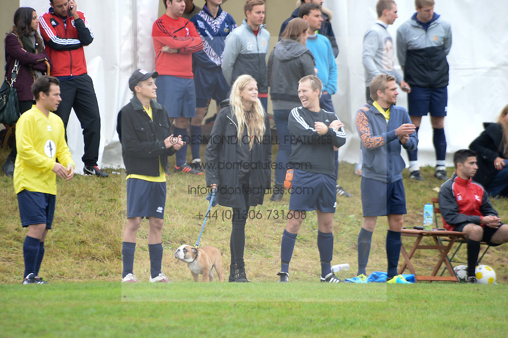 Centre, GABRIELLA ANSTRUTHER-GOUGH-CALTHORPE (Actress Gabriella Wilde) and ALAN POWNALL at the Ripley Football Tournament hosted by Irene Forte in aid of The Samaritans held at Ryde Farm, Hungry Hill Lane, Ripley, Surrey on 14th September 2013.  After the football guests enjoyed an after party.