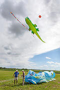 Bernhard Dingwerth and and Andreas Napravnik of Germany prepare kites for launch. Windscape Kite Festival, Swift Current, Saskatchewan.