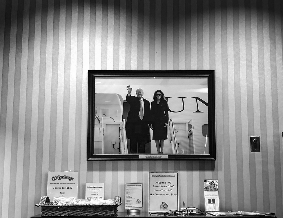 A photogra[h of U.S. President Donald Trump and his wife Melania hangs on a wall in a reception room at Joint Base Andrews, outside Washington, DC.