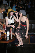 KATHRYN FERGUSON AND NAOMI HART, A Party To Celebrate the Launch of 'A Hedonist's Guide To Life' Maya. Dean St. London. 23 October 2007. -DO NOT ARCHIVE-© Copyright Photograph by Dafydd Jones. 248 Clapham Rd. London SW9 0PZ. Tel 0207 820 0771. www.dafjones.com.