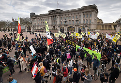 © Licensed to London News Pictures. 03/04/2021. London, UK. Protesters march past Buckingham Palace in central London during a 'Kill the Bill' demonstration and rally. A coalition of groups including Extinction Rebellion, Kill the Bill & Black Lives Matter are coming together over the Easter weekend to campaign against the proposed Police, Crime, Sentencing and Courts Bill which will give police in England and Wales more power to impose conditions on non-violent protests. Photo credit: Peter Macdiarmid/LNP