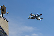 A Lockheed P-3C Orion Maritime reconnaissance aircraft with the Japanese Self Defence Force flies low over houses in Tsuruma, Kanagawa, Japan Friday December 15th 2017