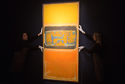 Christie's, London, March 3rd 2017. PICTURED: Gallery staff straighten Mark Rothko's 'No.1', painted in 1949, which is expected to fetch between £8-12 million.  <br /> Fine art auctioneers Christies hold a press preview for their Post-War and Contemporary Art auctions to be held on March 7th and 8th.