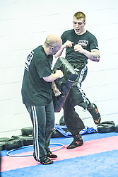 Students practising their kicking and punches with pads. Stef Noij, KMG Instructor from the Institute Krav Maga Netherlands, takes the IKMS G Level Programme seminar today at the Scottish Martial Arts Centre, Alloa.