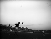 07/09/1960<br /> 09/07/1960<br /> 07 September 1960<br /> Soccer: City Cup Final, Drumcondra v Cork Celtic at Tolka Park, Dublin. Cork Celtic centre-half, Coughlan heads the ball clear despite the attention of McCaffery of Drumcendra (left).