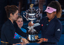 BEIJING, Jan. 27, 2019  Li Na (L front) of China presents the trophy to Naomi Osaka of Japan during the trophy awarding ceremony after the women's singles final match between Naomi Osaka of Japan and Petra Kvitova of the Czech Republic at 2019 Australian Open in Melbourne, Australia, Jan. 26, 2019. (Credit Image: © Xinhua via ZUMA Wire)