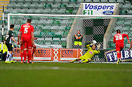 Plymouth Argyle goalkeeper Luke McCormick dives the right way but is unable to keep out York City's Luke Summerfield's penalty during the Sky Bet League 2 match between Plymouth Argyle and York City at Home Park, Plymouth, England on 28 March 2016. Photo by Graham Hunt.