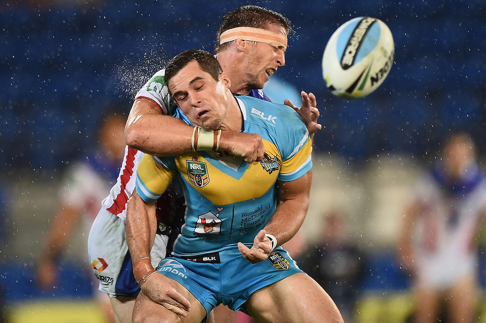 GOLD COAST, AUSTRALIA - MARCH 22:  Daniel Mortimer of the Titans is tackled by Kurt Gidley of the Knights during the round three NRL match between the Gold Coast Titans and the Newcastle Knights at Cbus Super Stadium on March 22, 2015 on the Gold Coast, Australia.  (Photo by Matt Roberts/Getty Images)
