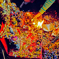 INDIA, Kashmir. Hindu worshippers leave offerings (prasad) in Amarnath Cave, after 5-day Himalayan pilgrimage to see ice lingam here.