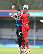 Kwadwo Baah of Rochdale (22) and Wigan Athletic defender Tendayi Darikwa (2)  challenge  tp head the ball during the EFL Sky Bet League 1 match between Rochdale and Wigan Athletic at the Crown Oil Arena, Rochdale, England on 16 January 2021.