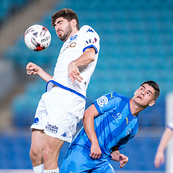 BRISBANE, AUSTRALIA - SEPTEMBER 20: Luke Pavlou of South Melbourne heads the ball in front of Benjamin Lyvidikos of Gold Coast City during the Westfield FFA Cup Quarter Final match between Gold Coast City and South Melbourne on September 20, 2017 in Brisbane, Australia. (Photo by Gold Coast City FC / Patrick Kearney)