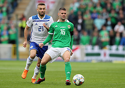 Northern Ireland's Oliver Norwood (right) and Bosnia and Herzegovina's Elvis Saric in action the UEFA Nations League, League B Group Three match at Windsor Park, Belfast.