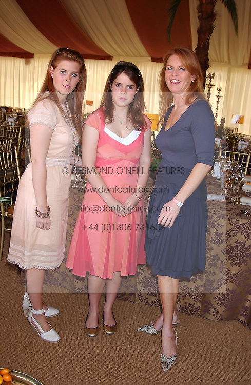Left to right, HRH PRINCESS BEATICE OF YORK, HRH PRINCESS EUGENIE OF YORK and their mother SARAH, DUCHESS OF YORK at the Veuve Clicquot sponsored Gold Cup Final or the British Open Polo Championship held at Cowdray Park, West Sussex on 17th July 2005.<br /><br />NON EXCLUSIVE - WORLD RIGHTS