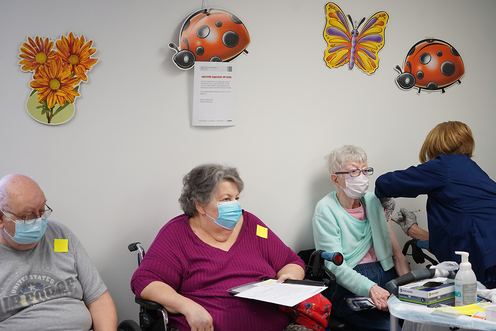 Residents wait to be vaccinated as Lehigh Valley Health Network brought their mobile vaccination clinic to Majestic House on May 6, 2021, which offers low income housing to Seniors 55 years and over, in Tamaqua, Pennsylvania.