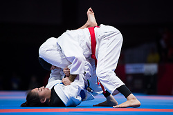JAKARTA, Aug. 24, 2018  Khan Jessa (below) of Cambodia competes against Mahra Alhinaai of the UAE during the Ju-Jitsu Newaza Women's -49 kg Final - Gold Medal competition of the 18th Asian Games in Jakarta, Indonesia, Aug. 24, 2018. Khan Jessa won the match and got the gold medal. (Credit Image: © Zhu Wei/Xinhua via ZUMA Wire)