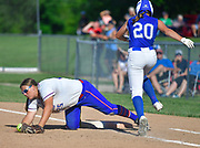 Freeburg batter Maleah Blomenkamp (right) leaps over Nashville first baseman Colleen Jahnke at first base and was ruled safe. Freeburg defeated Nashville in the Class 2A sectional softball title game at Nashville High School in Nashville, IL on Thursday June 10, 2021. Tim Vizer/Special to STLhighschoolsports.com.