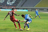 Bu Xin of Harbin Yiteng, right, challenges Ransford Addo of Shanghai East Asia during their 28th round match of the 2014 Chinese Football Association Super League in Harbin city, northeast China's Heilongjiang province, 19 October 2014.<br /> <br /> Harbin Yiteng drew with Shanghai East Asia 1-1.