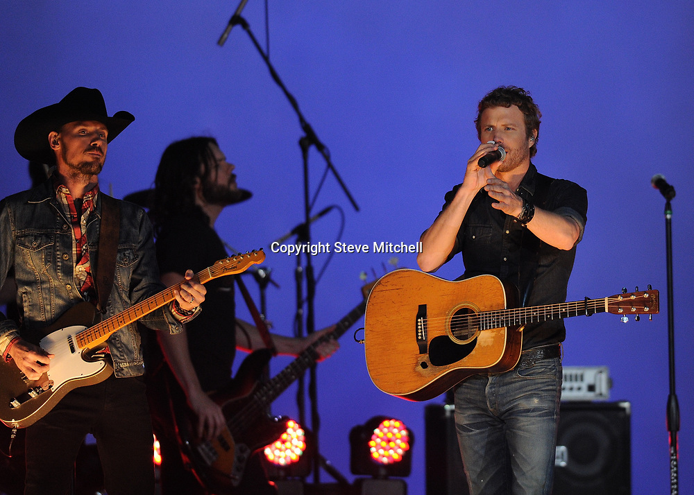 Jan 3, 2014; Miami Gardens, FL, USA; Country music singer Derek Bentley performs during the half time show in the 2014 Orange Bowl college football game between Ohio State Buckeyes and Clemson Tigers at Sun Life Stadium. Mandatory Credit: Steve Mitchell