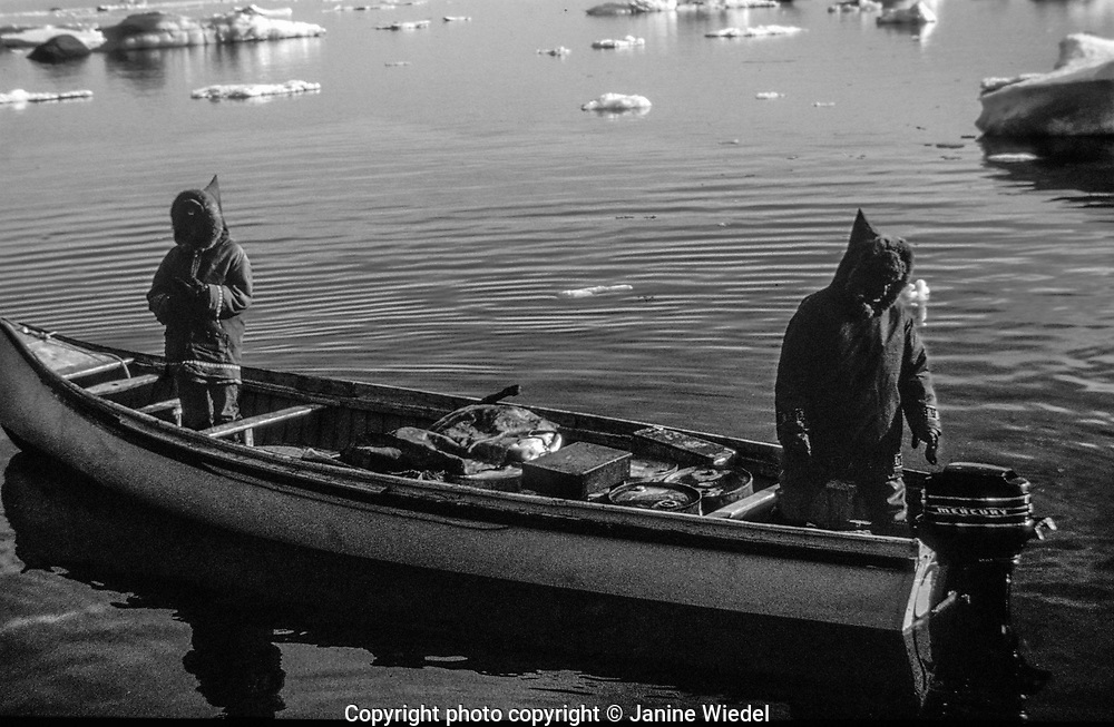 Midnight fishing . Inuit life in the Canadian Arctic settlement of Pangnirtung in the territory of Nunavut (North West Territories) 1973