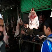 November 15, 2012 - Kabul, Afghanistan: A vendor stands at his meet stall in the market area in central Kabul. (Paulo Nunes dos Santos)