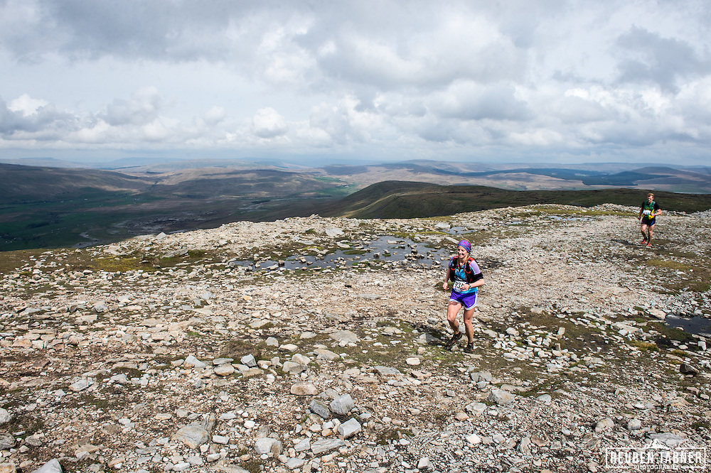 Runners run along the plateau of Ingleborough in the Yorkshire Dales during the 60th Yorkshire Three Peaks Race.