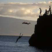 Jumping of Black Rock into the Pacific Ocean in Ka'anapali on island of Maui.