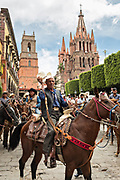 Mexican cowboys are sprinkled with holy water by Catholic priests blessing their pilgrimage celebrating the festival of Saint Michael in San Miguel de Allende, Mexico.