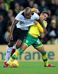 Derby County's Andre Wisdom (left) and Norwich City's Max Aarons battle for the ball during the Sky Bet Championship match at Carrow Road.
