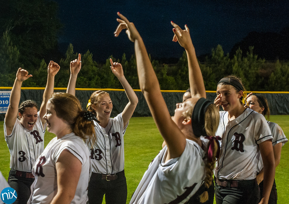 Jay M. Robinson players celebrate a win against Marvin Ridge Tuesday night during the fourth-round game of the NCHSAA softball playoffs. Robinson won the game 3-2 to advance to the the regional round.