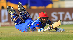 September 20, 2018 - Abu Dhabi, United Arab Emirates - Afghanistan cricketer Hashmatullah Shahidi dives in to complete a run during the 6th cricket match of Asia Cup 2018 between Bangladesh and Afghanistan at the Sheikh Zayed Stadium,Abu Dhabi, United Arab Emirates on September 20, 2018. (Credit Image: © Tharaka Basnayaka/NurPhoto/ZUMA Press)
