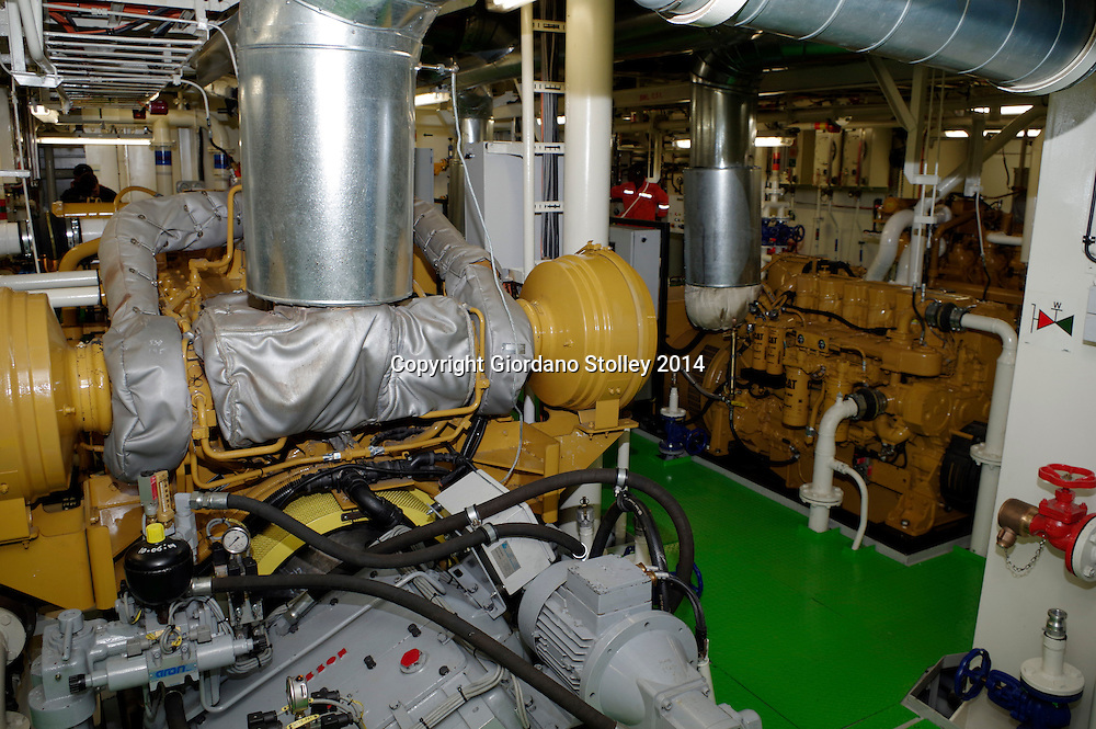 DURBAN - 11 August 2014 - The engine room of the grab hopper dredger, Italeni, which was at anchor in Durban following her maiden voyage from the Bulgarian shipyards where she was constructed. The vessel is the second of three dredgers that the Dutch shipbuilder IHC Merwede has been contracted to build for South Africa's Transnet National Ports Authority. It is 62 metres long and 15 metres wide with a  gross tonnage of 1000 tons and a dead weight of 1490 tons.  These engines can give the vessel a top speed of 12 knots. Picture: Allied Picture Press/APP