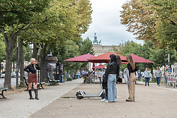 16 September 2021, Berlin, Germany: A group of women take photos of each other at the historical site of Unter den Linden in Berlin.