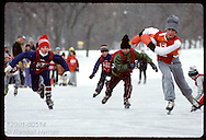 Young skaters fight toward finish line of 100-meter race on Lake Como; St. Paul Winter Carnival. Minnesota