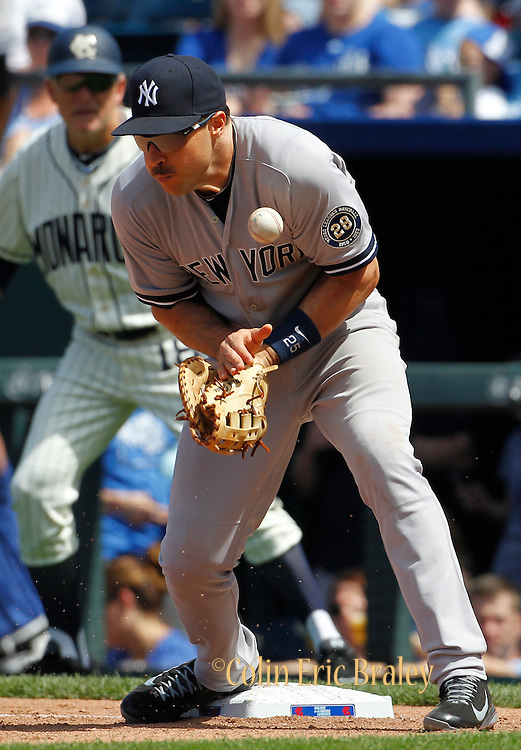 New York Yankees first baseman Mark Teixeira is unable to catch a throw from second baseman Stephen Drew on a hit by Kansas City Royals' Omar Infante during a baseball game at Kauffman Stadium in Kansas City, Mo., Sunday, May 17, 2015. Teixeira was charged with error on the sixth inning play. (AP Photo/Colin E. Braley)