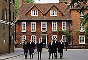 Eton schoolboys in traditional tailcoats at Eton College boarding school, Berkshire, UK.