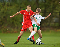 WREXHAM, WALES - Wednesday, October 30, 2019: Wales' captain Zak Williams (L) and Republic of Ireland's Cian Philpott during the 2019 Victory Shield match between Wales and Republic of Ireland at Colliers Park. (Pic by David Rawcliffe/Propaganda)