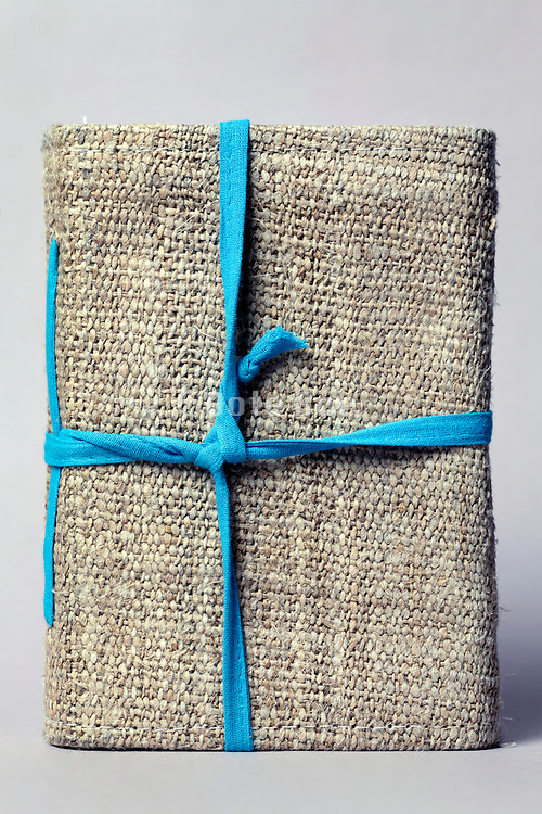 notebook cover made from raw rough canvas and blue cord