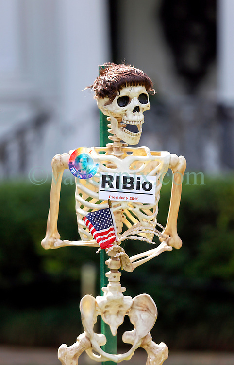 30 October 2015. New Orleans, Louisiana.<br /> The Skeleton Krewe mansion on St Charles Avenue at the corner of State Street draws crowds with its satirically spooky Halloween decorations. American politics comes under fire with skeletons depicting Presidential hopeful Marco Rubio as 'Rib-io.'<br /> Photo©; Charlie Varley/varleypix.com