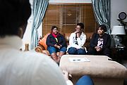 Qiana Holmes Abanukam, Marilyn Ruffin, and Teresita Torrence speak during their book club meeting in Sun Prairie, Wisconsin, Friday, Oct. 26, 2018.