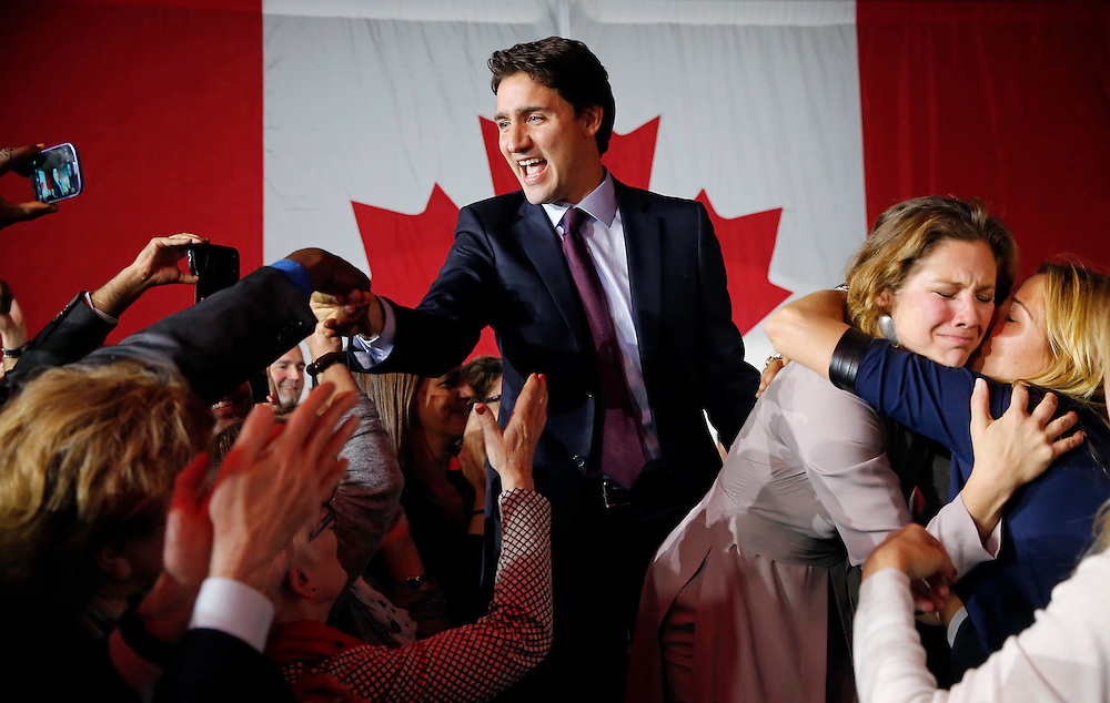 Liberal Party leader Justin Trudeau and his wife Sophie Gregoire are greeted by supporters as he arrives to give his victory speech after Canada's federal election in Montreal, Quebec, October 19, 2015.  REUTERS/Jim Young