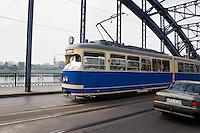 Classic style of tram crossing the Pilsudskiego bridge towards Podgorze from Krakow Poland