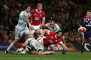 Jonathan Thomas of Wales gets the ball out from a tackle.  Invesco perpetual series, Wales v Argentina at the Millennium Stadium in Cardiff on Sat 21st Nov 2009. pic by Andrew Orchard, Andrew Orchard sports photography,