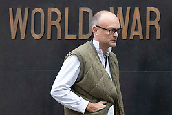 © Licensed to London News Pictures. 16/09/2019. London, UK. Special adviser to the Prime Minister Dominic Cummings passes the Women of World War II sculpture as he arrives in Whitehall. Photo credit: George Cracknell Wright/LNP