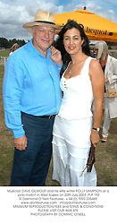 Musician DAVE GILMOUR and his wife writer POLLY SAMPSON at a polo match in West Sussex on 20th July 2003.PLP 193
