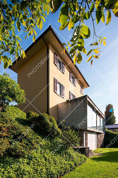 Beautiful house in the middle of the greenery with a modern reinforced concrete connection and a large window.
